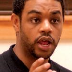Brandon Davis, the Missouri/Kansas State Council and Political Director for the Service Employees International Union (SEIU) briefs constitutes on the banning of a affirmative action bill being pushed across the state of Missouri during a forum at the 100 Black Men office Monday night.       Photo by Wiley Price